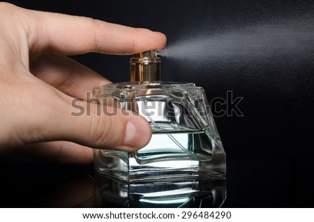 men's perfume bottle on a black background - stock photo