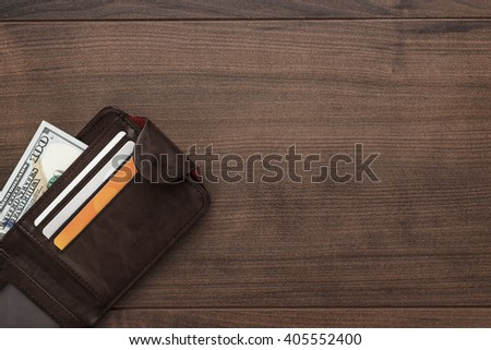 men's purse with money, credit and debit cards on the wooden table - stock photo