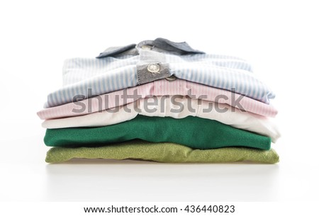 men's shirts stacked on white background