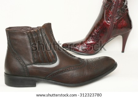Men's shoes and ladies shoes, symbolic photo for partnership and equality