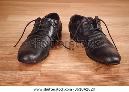Men's shoes on wooden background