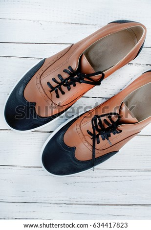 Men's shoes sportiven Bill on wooden background. Stylish men's shoes. Men's leather shoes.