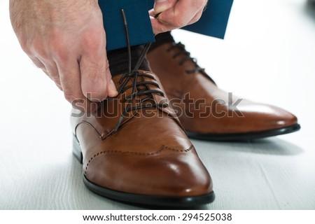 Men's shoes tying shoelaces.men wear wedding shoes - stock photo
