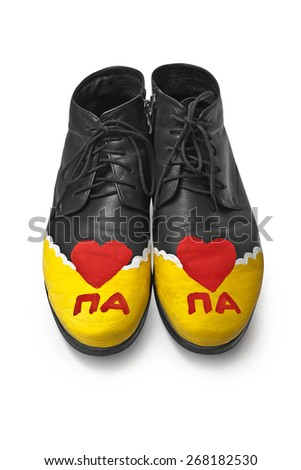 "Men's shoes with the child's picture and the inscription ""dad"" in Russian - stock photo"