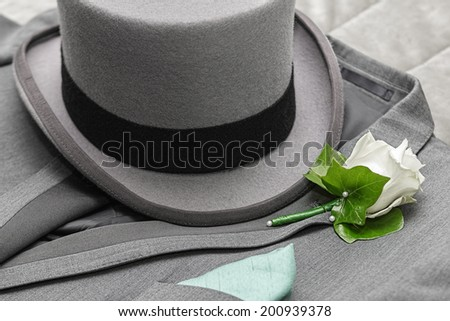 Men's suit, tall hat and boutonniere - stock photo