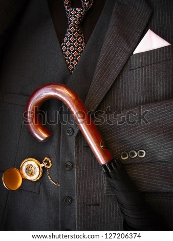 Men's suit with umbrella. Low-key image. - stock photo
