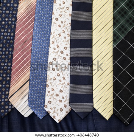 Men's ties against a textile background - stock photo
