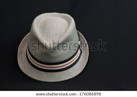 Men's trilby hat on a very dark background.
