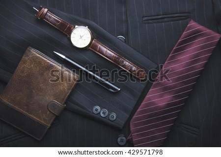 Men's wallet, watch, tie on suit - stock photo