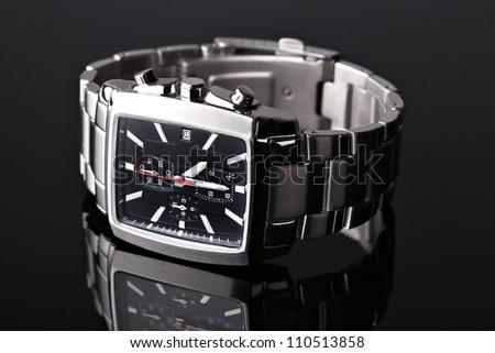 Men's watch on black - stock photo