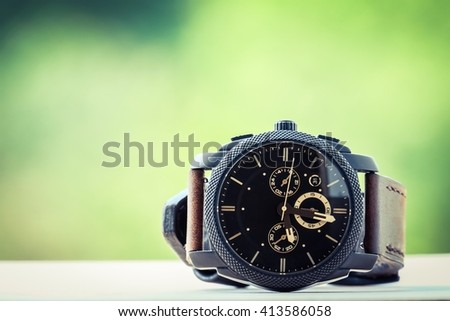 Men's watch with leather strap  - stock photo