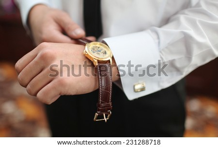 men's watches on the arm - stock photo
