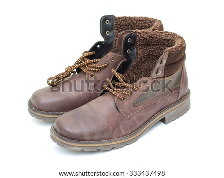 men's winter boots on a white background - stock photo