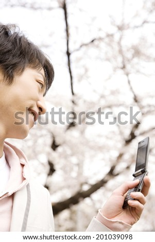Men seeing the mobile phone - stock photo