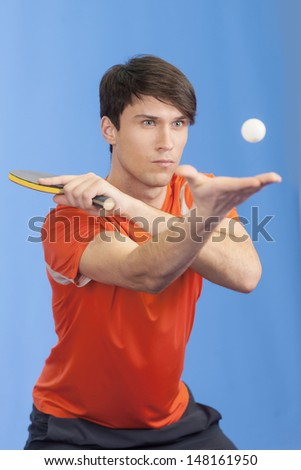 Men serving a ball. Confident young men playing table tennis - stock photo