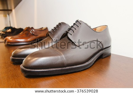 Men shoes in a store - stock photo