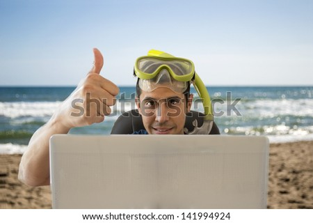men showing a thumbs up when achieved a great deal for your holiday on the beach - stock photo
