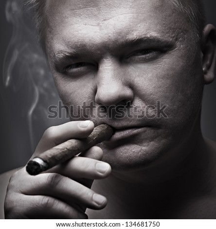 men smoking cigar, gray background - stock photo
