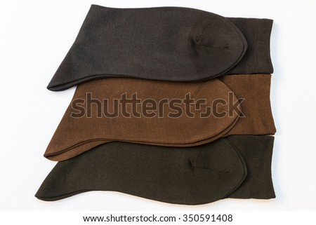 Men socks, blue, brown and black on a white background. - stock photo