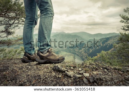 Men stay in Mountains footwear on the beautiful view. - stock photo