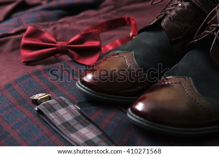 Men suit, accessories, vintage leather shoes, bow tie and wedding rings - stock photo