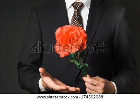 Men suit to present the red roses