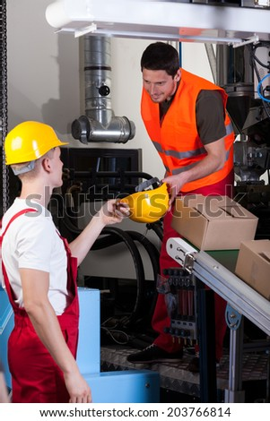 Men taking care about safety at warehouse, vertical