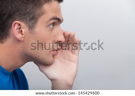 Men telling gossips. Handsome young men gossiping while standing isolated on white - stock photo