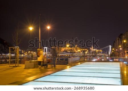 men walking in the night Budapest - stock photo