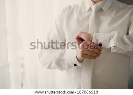 men wear a shirt and cufflinks - stock photo
