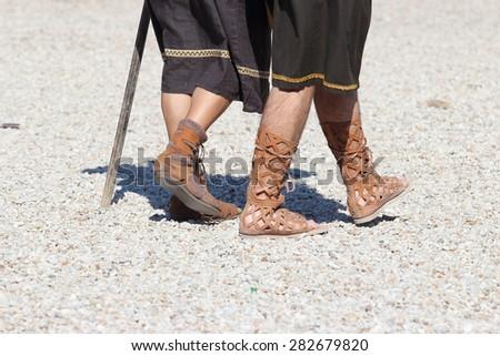 men wearing caligae ancient roman shoes - stock photo