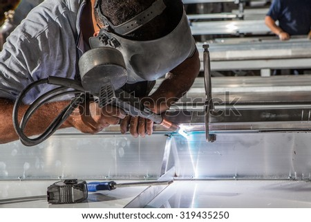 men welding at the industrial factory - stock photo