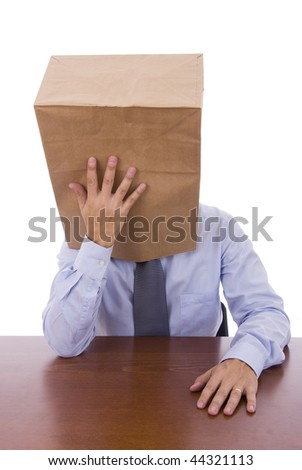 Men with a cardboard bag on his head thinking - stock photo
