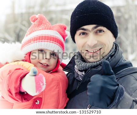 men with baby in winter - stock photo