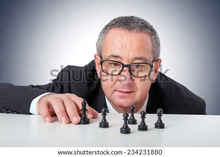 Men with chess pieces on the desk