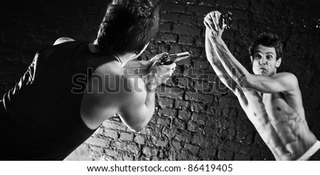 Men with guns fighting. Black and white. - stock photo