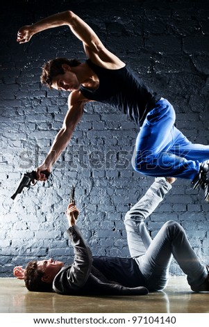 Men with guns fighting. Contrast colors. - stock photo