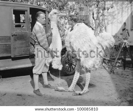 Men with ostrich costume - stock photo