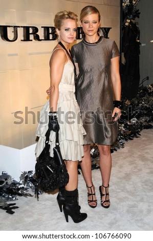 Mena Suvari and Amy Smart  at the Burberry Beverly Hills Store Re-Opening. Burberry Beverly Hills Store, Beverly Hills, CA. 10-20-08 - stock photo