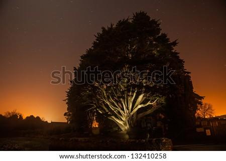 Menai Bridge and the graveyard at sunset Isle of Anglesey North Wales - stock photo