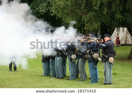 MENANDS - September 13: Union Soldiers Fire Their Rifles During a Civil War Reenactment at the Albany Rural Cemetery on September 13, 2008 in Menands, NY.