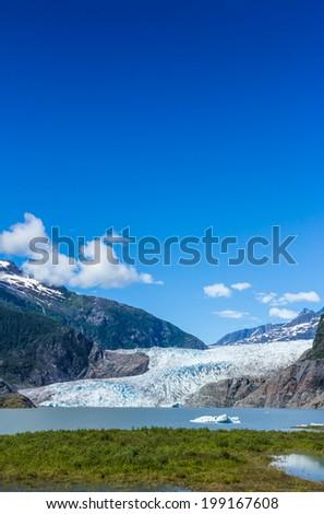 Mendenhall Glacier and Lake in Juneau, Alaska, USA in summer - stock photo
