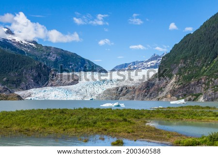 Mendenhall Glacier and Lake in Juneau, Alaska, USA in summer - stock photo