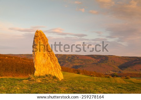 Menhir on the hill at sunset in Morinka village, Czech Republic