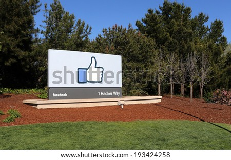 MENLO PARK, CA -Â?Â? MARCH 18: A sign at the entrance to the Facebook World Headquarters located in Menlo Park, California on March 18, 2014. Facebook is a popular online social networking service. - stock photo