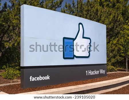 MENLO PARK, CA/USA - MAY 31, 2014: Facebook corporate headquarters campus sign in Silicon Valley. Facebook is a social networking website that allows users to keep in touch with friends. - stock photo