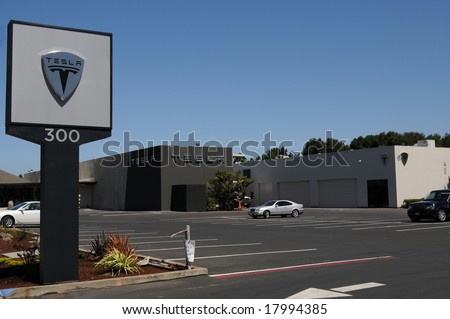 MENLO PARK-JULY 31: Tesla Roadster is the first plug-in electric car in years in production in the US. In July, Tesla Motors opened a showroom in Menlo Park, California, pictured on July 31, 2008. - stock photo