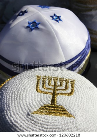 menorah - a symbol of Hanukkah, embroidered with gold thread on Jewish religious cap - stock photo