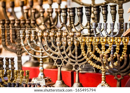 Menorah for sale in shop in the Jerusalem old city market. Hanukkah Jewish holiday is observed for eight nights and days.  - stock photo