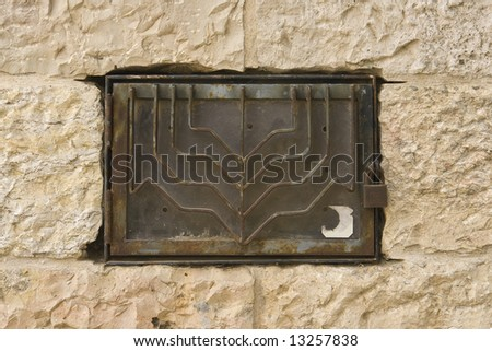 Menorah on a stone wall - stock photo